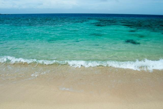 Idyllic sandy beach and blue ocean